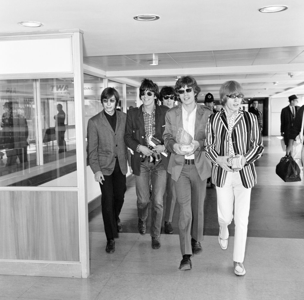 The Rolling Stones leaving for a month long tour of America. Left to right: Charlie Watts, Keith Richards, Bill Wyman, M